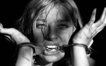 blondes women models people grayscale handcuffs faces shackles biting black background 1920x1200_www.artwallpaperhi.com_66
